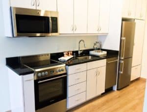 fully furnished kitchen at The Rhythm furnished by Home Networks
